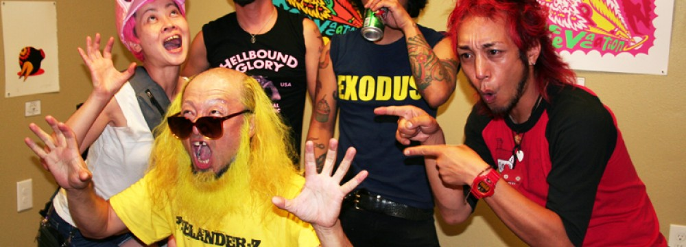 Peelander Z posing in their normal states after Kengo Hioki's (Peelander Yellow's) art show last night at Guzu Gallery in Austin, Tx.